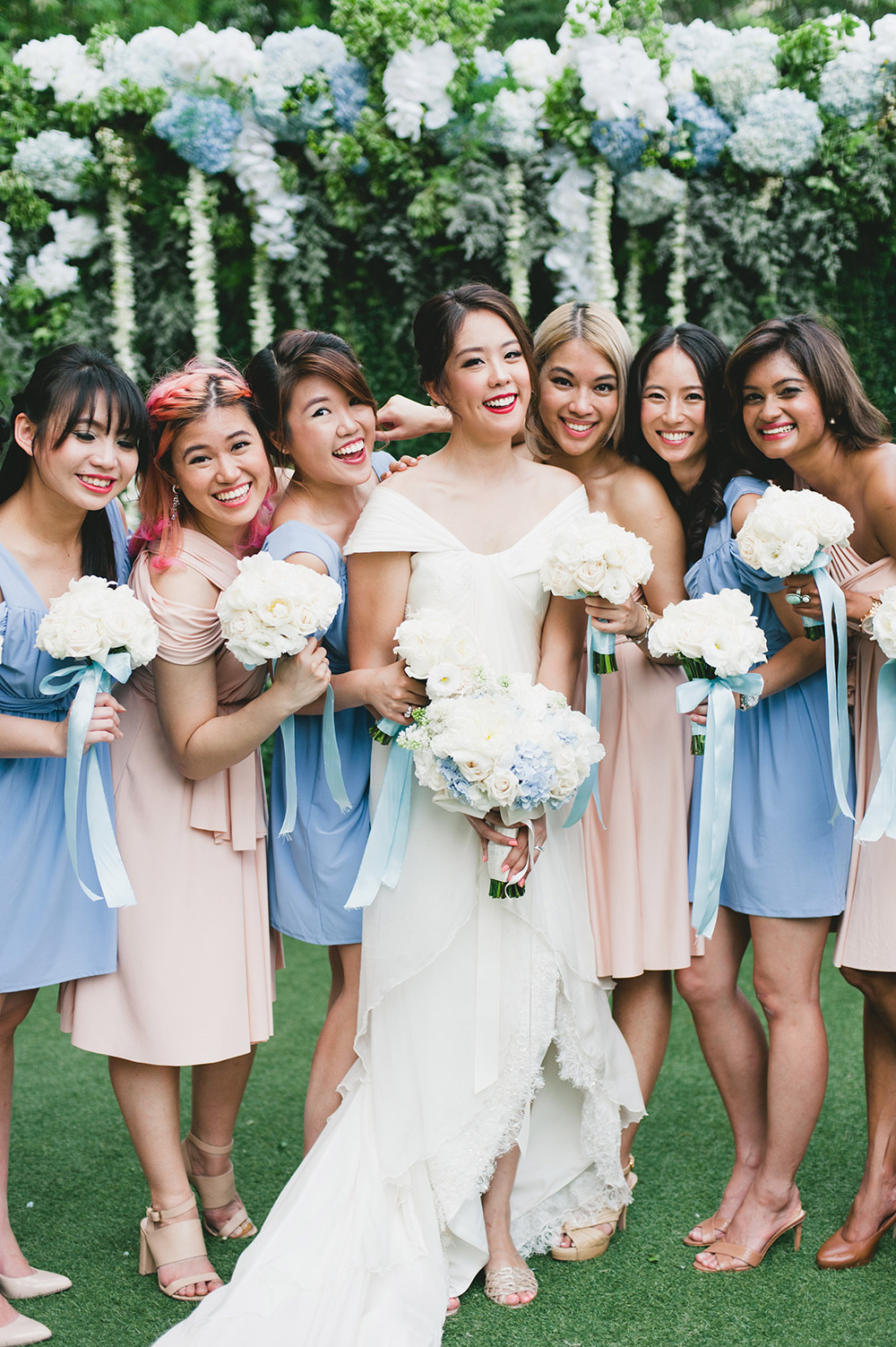 Pastel colour bridesmaids. Photo by Inlight Photos. www.theweddingnotebook.com