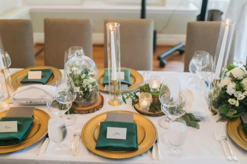 fresh look design green and gold place setting for wedding guests