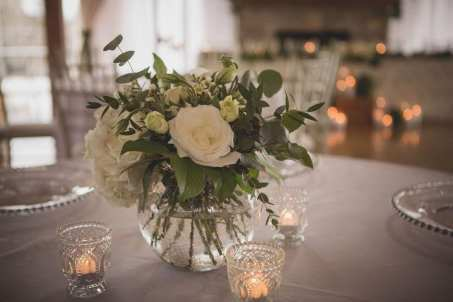 fresh look design small white wedding floral centrepiece