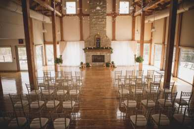 fresh look design chivary chairs setup for a wedding ceremony in front of a fireplace