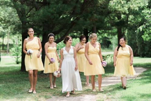 BridesMade bride with her bridesmaid dressed in short yellow bridesmaid dresses
