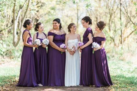 bride with her bridesmaids dresses in long purple bridesmade dresses