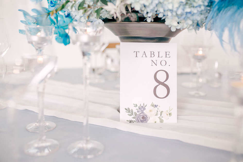 white and blue floral table number card