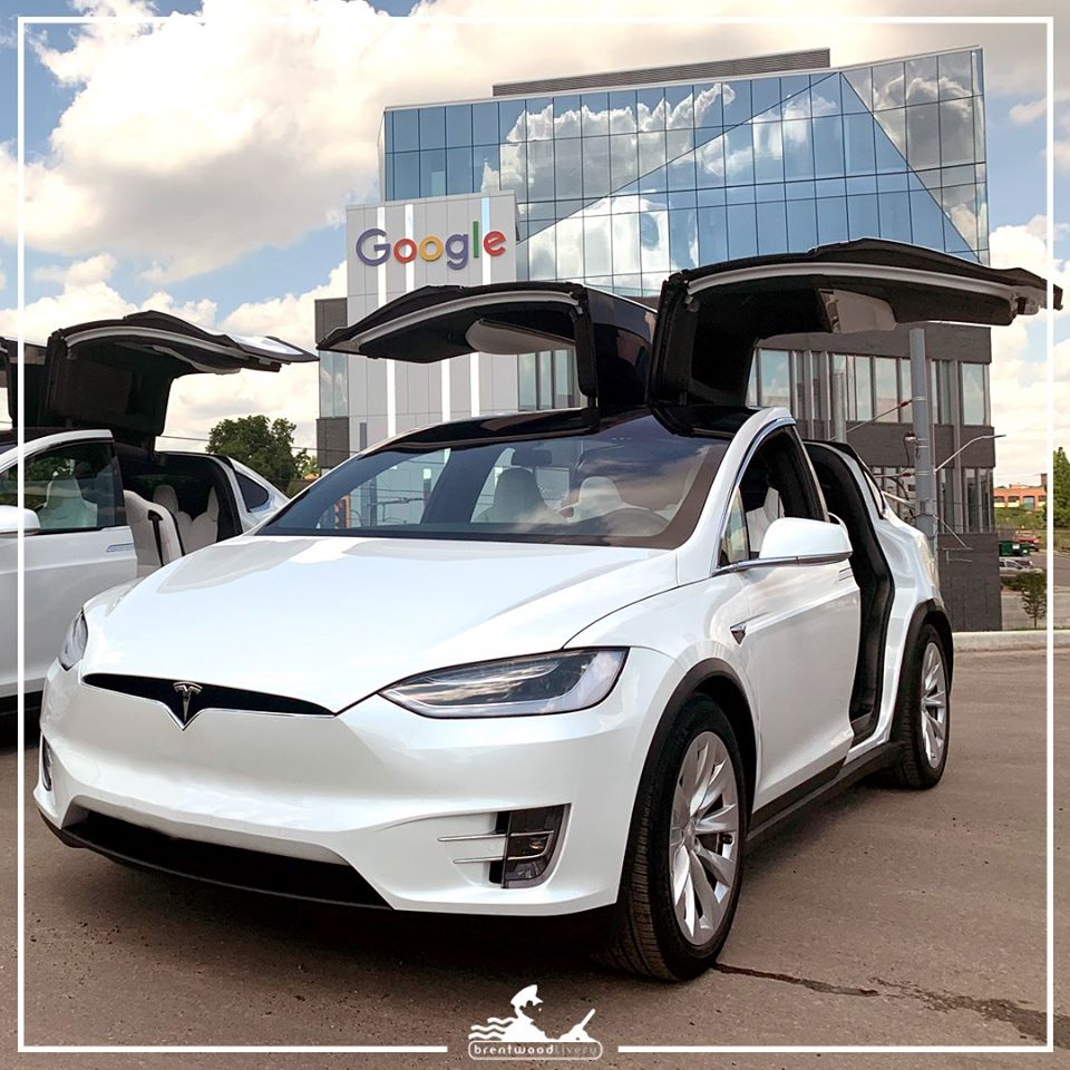 white tesla limo from brentwood livery