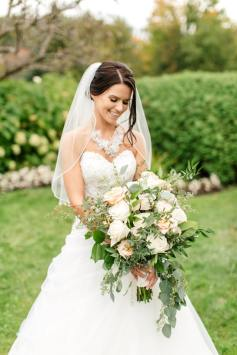 creme couture bride with large bouquet in a line strapless wedding gown