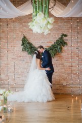 First Kiss at an Arlington Hotel Wedding - La Petite Fleur | Photo: Wendy Alana Photography