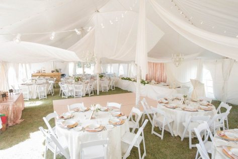 Now & Always white and blush tent wedding on grass with white folding chairs soft and romantic