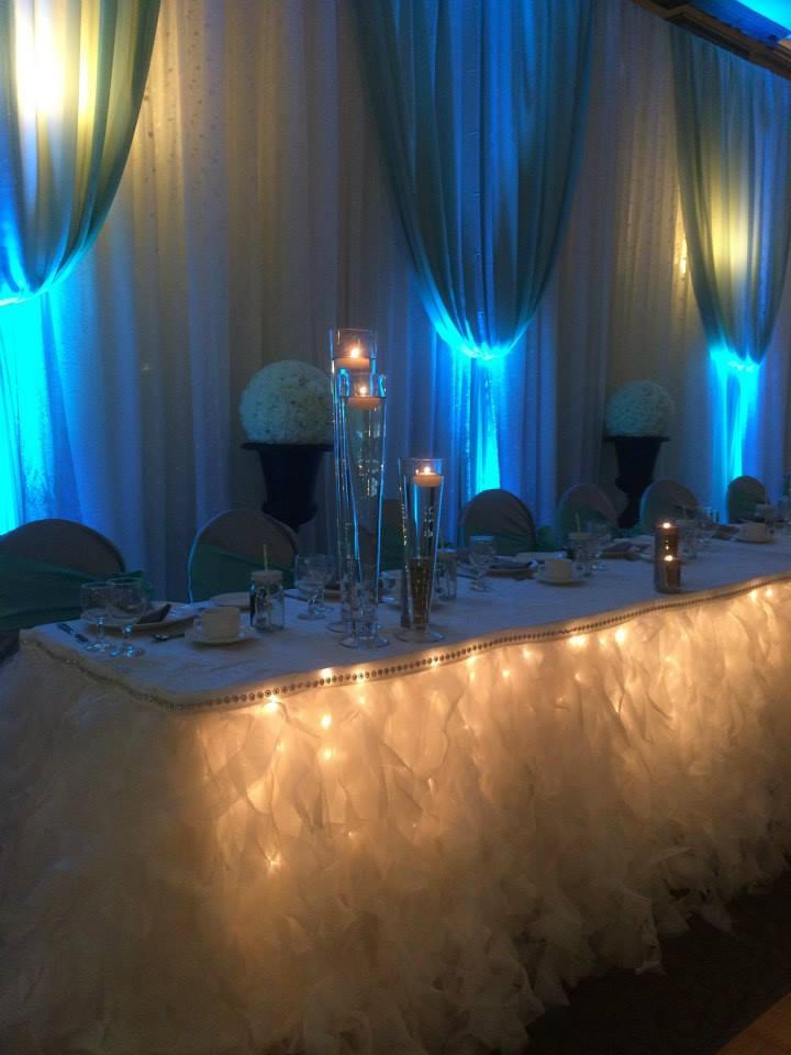 Now & Always wedding head table skirting with twinkle lights
