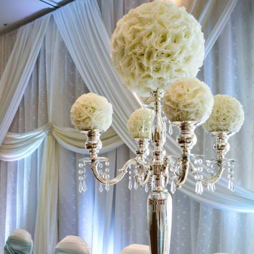 Now & Always white flower balls on silver candelabras with crystals
