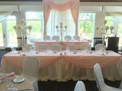 Now & Always two tier head table with a window backdrop