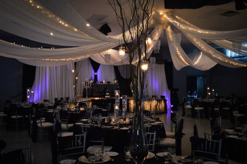 Now & Always wedding ceiling treatment in white with purple uplighting