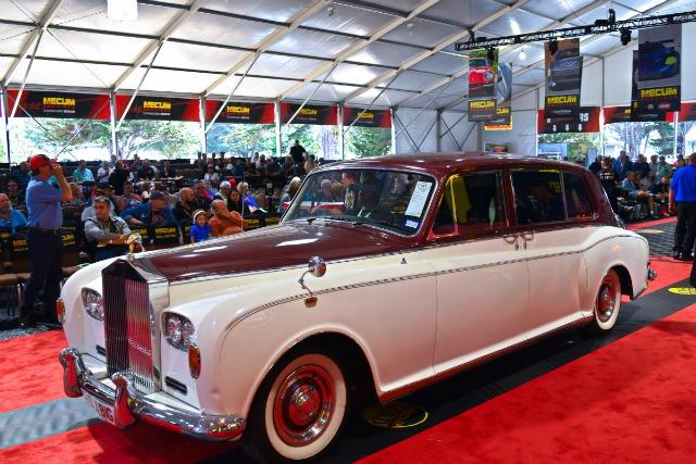 A vintage Rolls-Royce on the auction carpet at the Mecum Auction during Classic Car Week in Monterey.