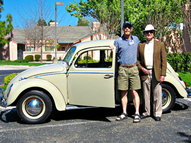 Bruce Aldrich and his father and the family's 1959 Volkswagen Bug.