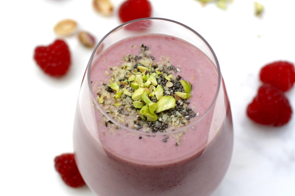 Berry Smoothie with almond milk, strawberries, raspberries, hemp seeds, chia seeds, banana,