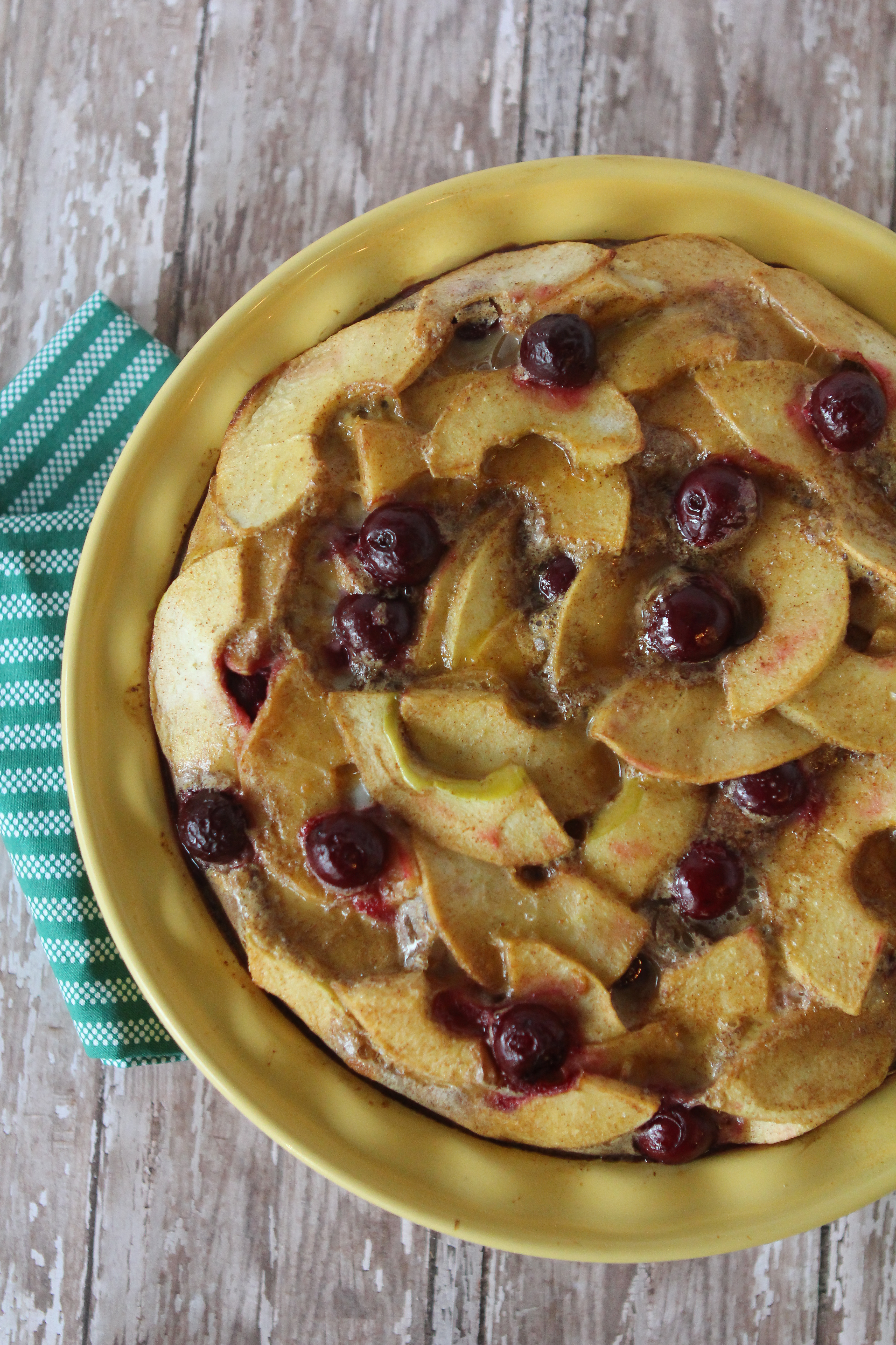 overhead shot of Paleo Fruit Breakfast Frittata with Cherries and Apples in a baking dish