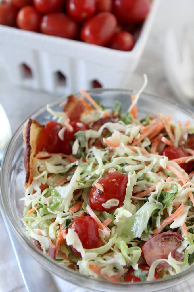 paleo Cole Slaw with bacon lettuce and tomatoes in a glass bowl