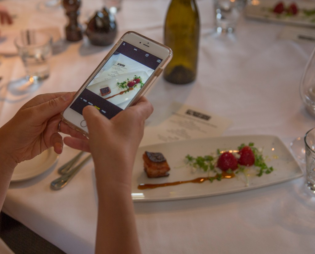 MONTEREY, Calif., June 6, 2016 Participants in the annual California Strawberry Commission's Influencer Farm Tour during the first day of the event eat at Montrio Bistro in Monterey, Calif., June 6, 2016. Photo by Robert Durell