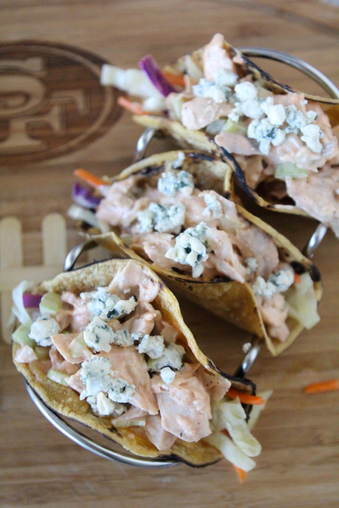 Gluten-Free Buffalo Chicken Tacos from the Whole Smiths. So easy to whip up and perfect for your gameday food cravings. A definite crowd-pleaser.