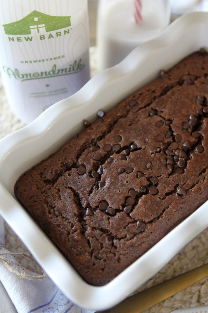 A loaf of grain-free Paleo Chocolate Banana Bread in a white ceramic loaf pan