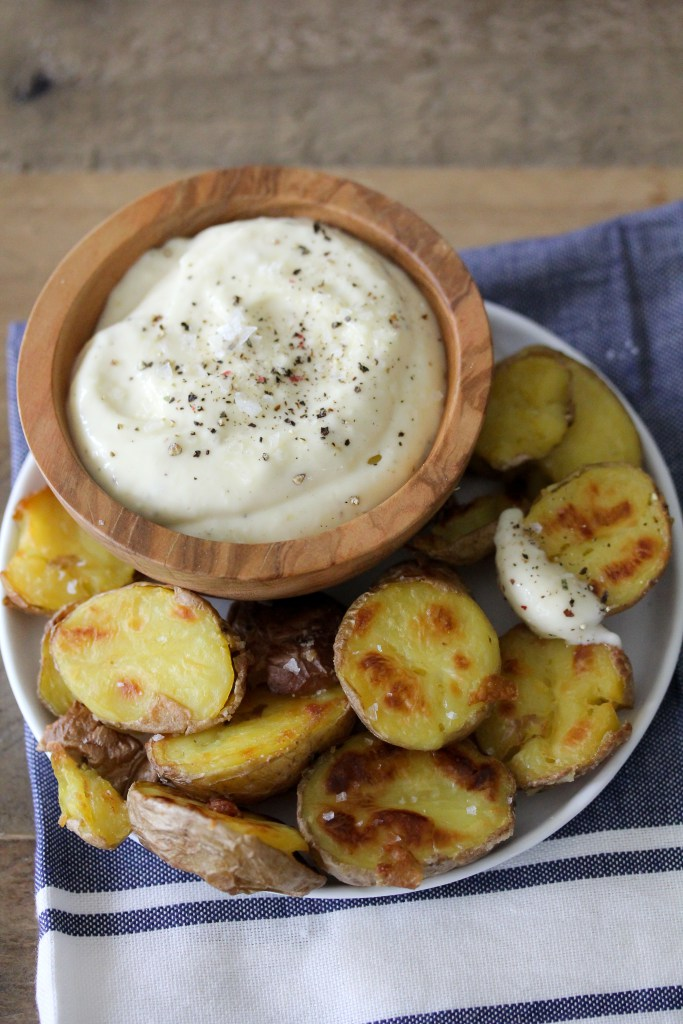 Whole30 compliant Patatas Bravas + Garlic Aioli by the Whole Smiths. Or in other words, the best, crispiest potatoes and garlic dipping sauce you'll ever had.