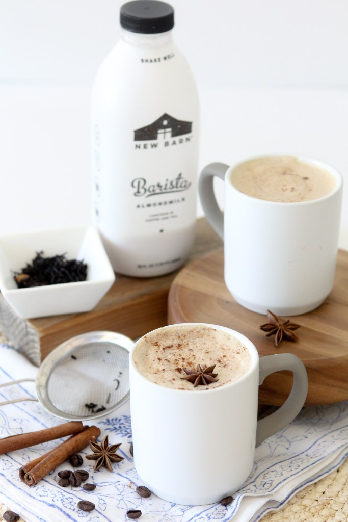 two mugs of Dairy-Free Dirty Chai Latte topped with steamed almond milk
