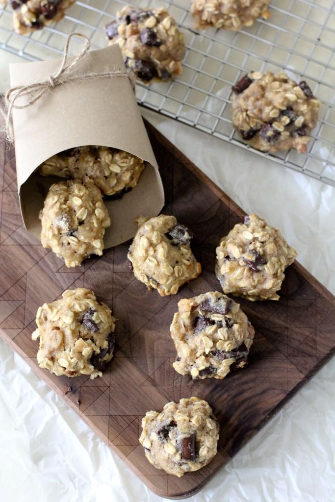 healthy gluten-free chunky monkey breakfast cookies on a wooden chopping board