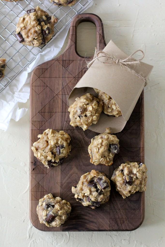 overhead shot of healthy chunky monkey breakfast cookies on a wooden chopping board