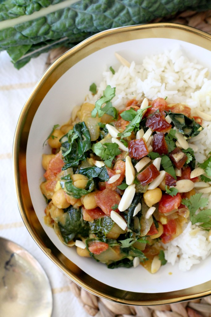 overhead shot of a bowl of vegan chickpea curry with kale served over rice