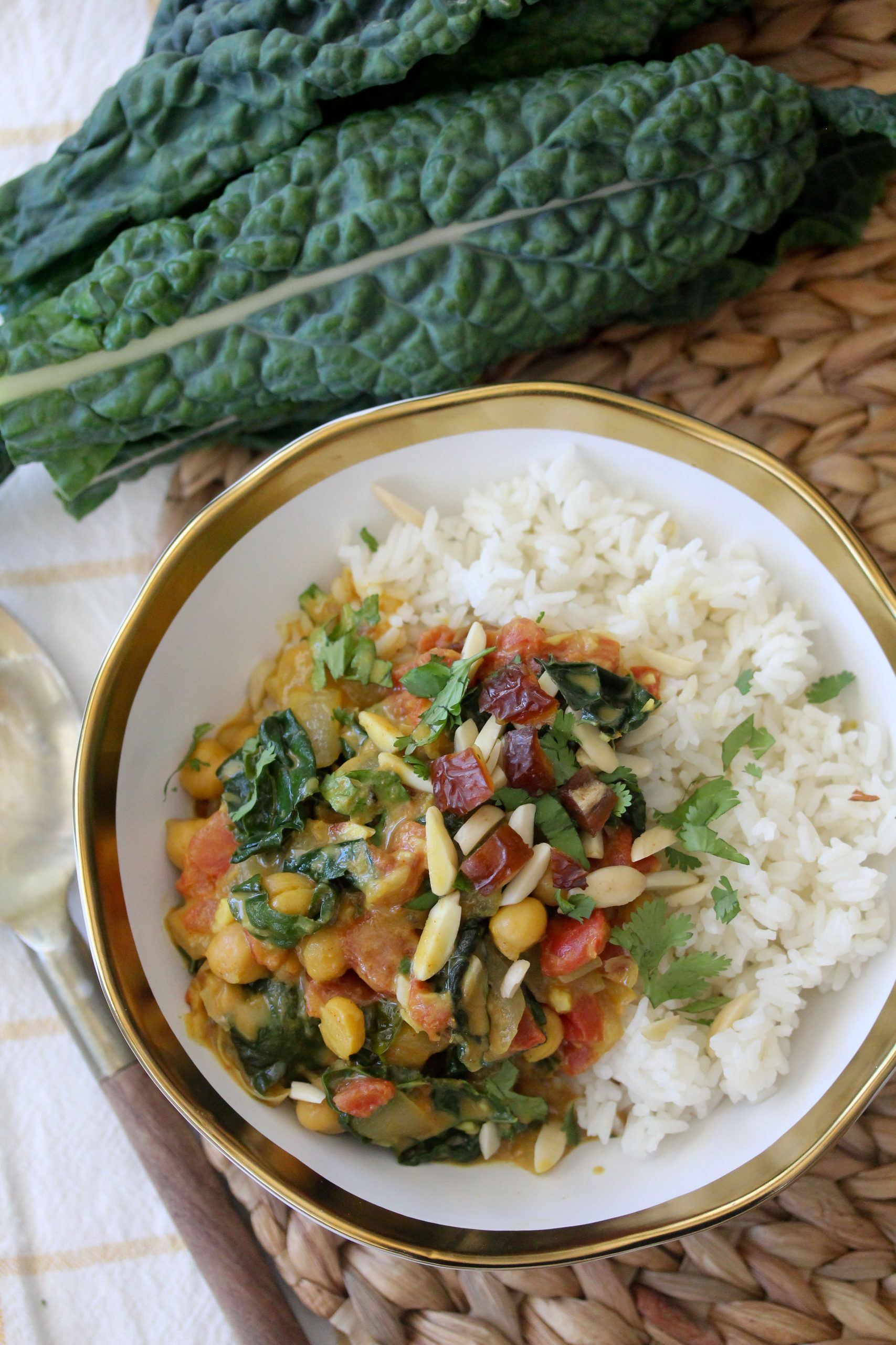 overhead shot of a bowl of vegan chickpea curry with kale