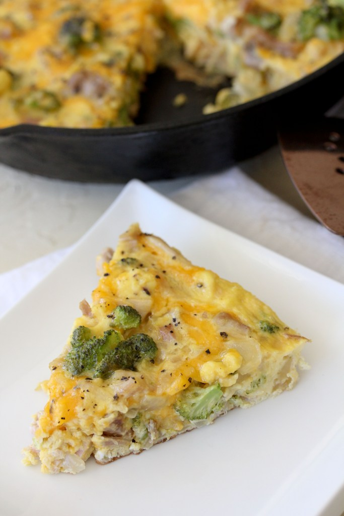 a piece of healthy frittata with broccoli, cheddar and chicken on a plate