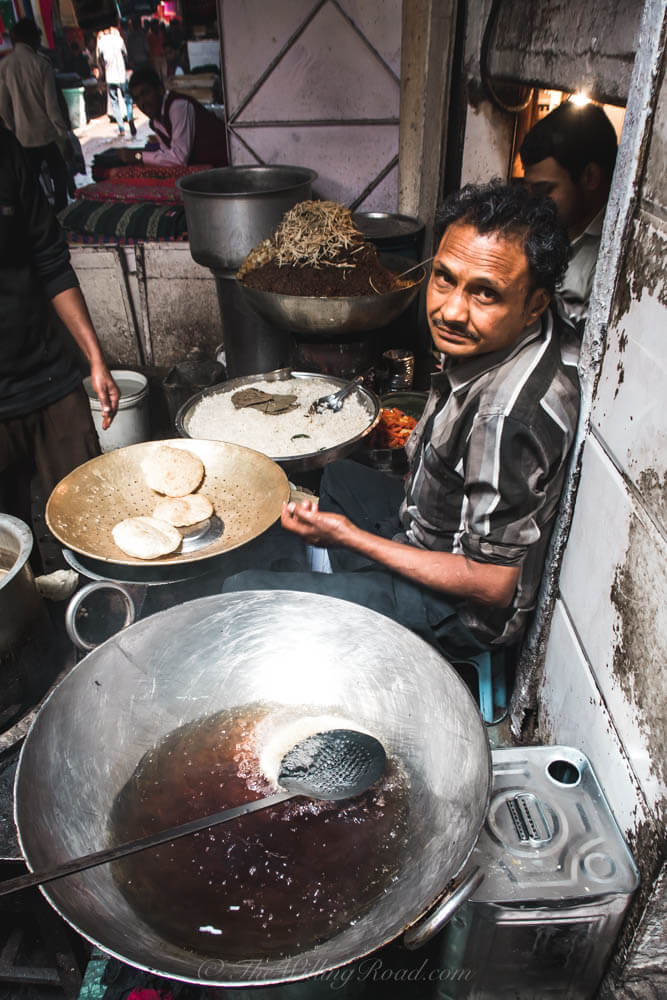 Chadni Chowk: a man sells puri and curry