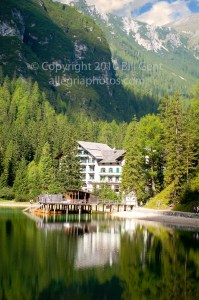 A hotel sits on the shores of Lago di Braies, Dolomites, Italy