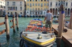 Produce arrives at the market on boards, Rialto, Venice