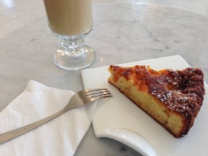 Enjoying a piece of frangipani torte and a cup of coffee for breakfast