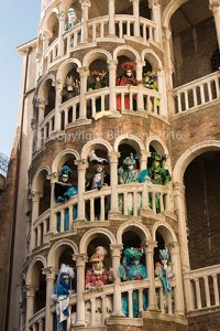 The Bovolo Staircase, also known as The Snail with Costumers during Venetian Carnival