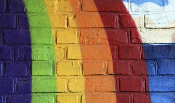 Rainbow painted on brick wall
