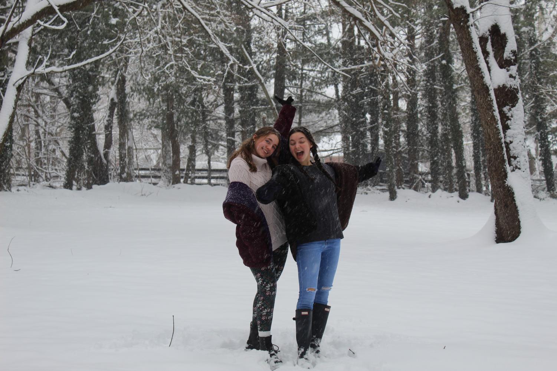 Carissa Vergeres and Mia Cammarota pose in the snow.