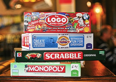You Can Play Board Games At These Chicago Bars   The Word Finder Blog  Stack of Board Games