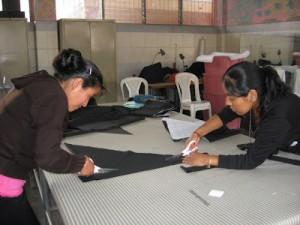 Mayan Artisan Studio workers cutting fabric