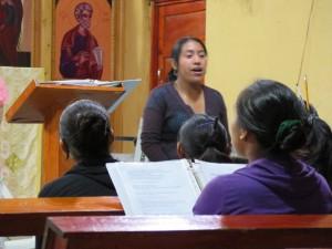 Juanita leads the choir in Aguacate