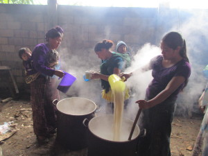 Mayan women cook for the men as they work