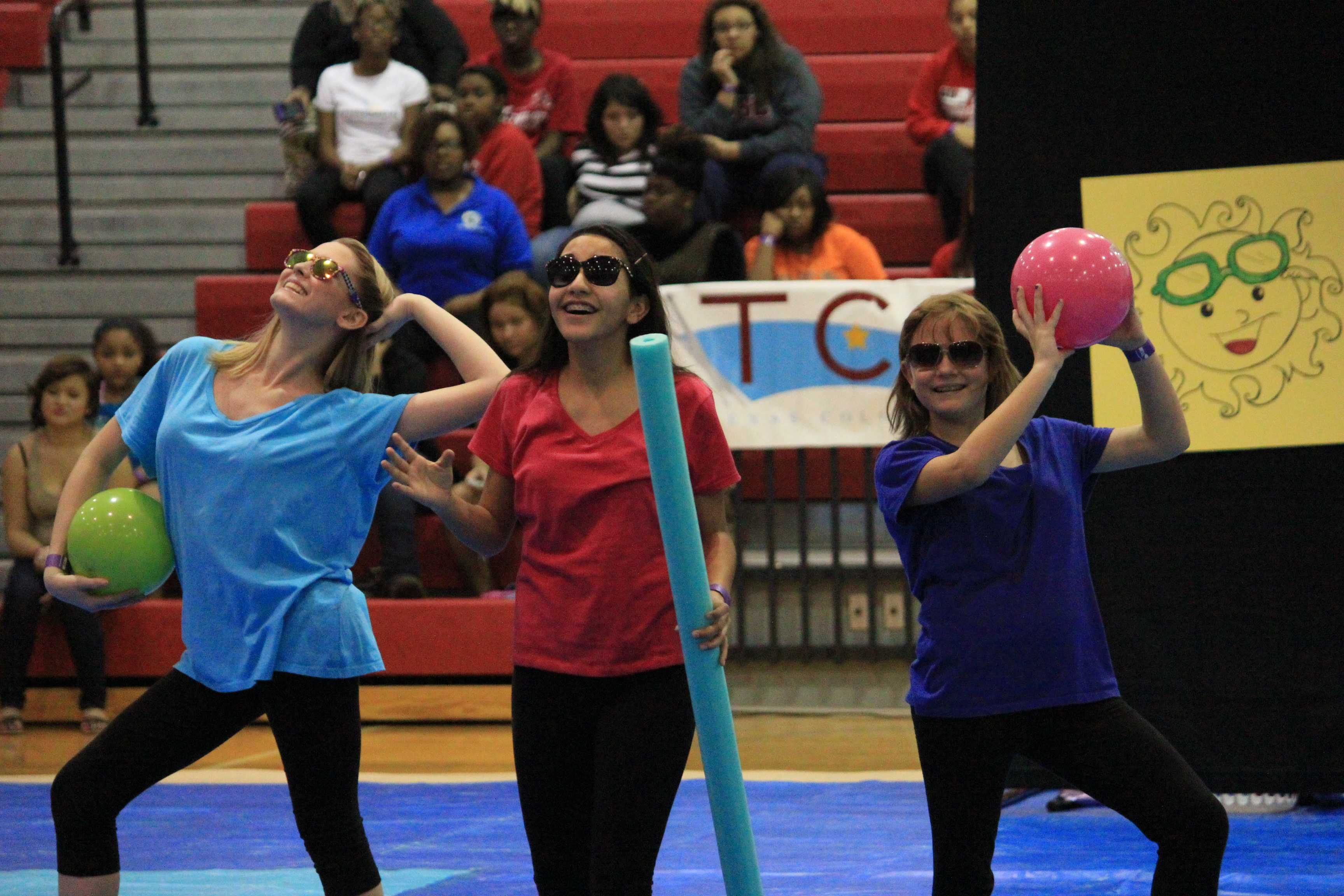 Color Guard members (left to right) Jenna Swift, Diana Vega, and Sarah Young begin their show