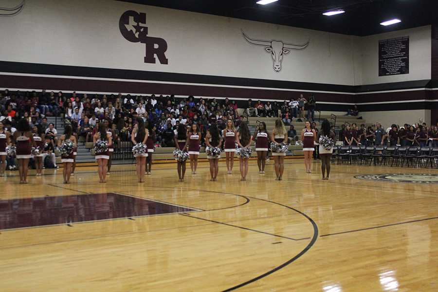 The+Lariettes+stand+in+lines+and+get+ready+to+introduce+the+Varsity+Volleyball+girls+into+the+gym.