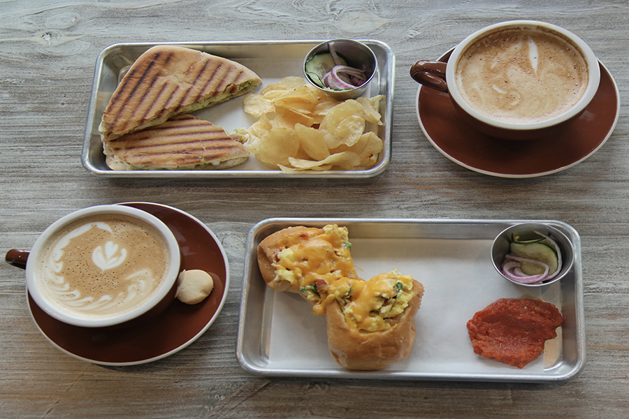 Top+left+is+the+Caprese+Panini+served+with+chips%2C+and+bottom+right+is+%22The+Egg%22+served+with+some+type+of+salsa.+
