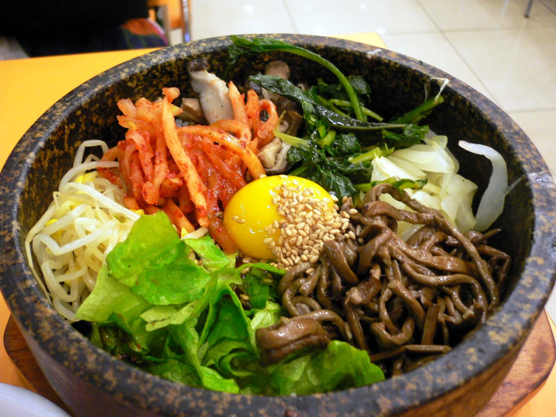 An authentic bowl of Bimbap, a traditional Korean dish, prepared at the burgeoning Korean restaurant, Bonchon.