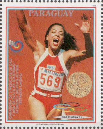 A stamp of Florence Griffith celebrating after winning the 100m final.