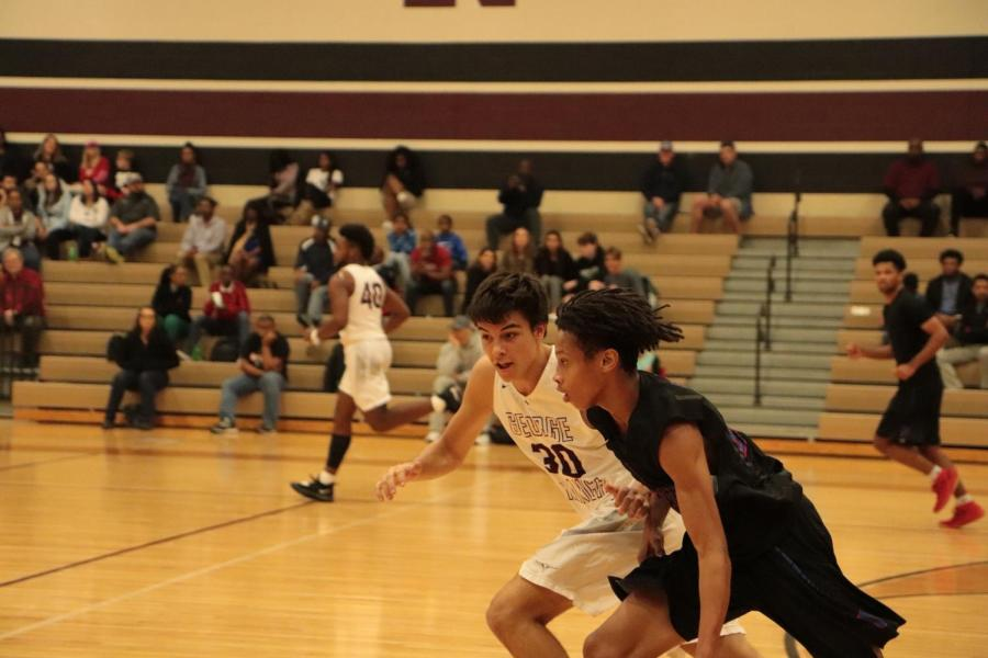 Caden+Cook+%2811%29+running+to+defend+and+block+the+shot