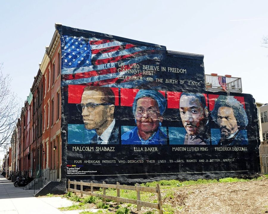 Mural+on+the+wall+of+row+houses+in+Philadelphia.+The+artist+is+Parris+Stancell%2C+sponsored+by+the+Freedom+School+Mural+Arts+Program.+Left+to+right%3B+Malcolm+Shabazz+%28Malcolm+X%29%2C+Ella+Baker%2C+Martin+Luther+King%2C+Frederick+Douglass.+The+quote+above+the+pictures%2C%22We+Who+Believe+in+Freedom+Cannot+Rest%22%2C+is+from+Ella+Baker%2C+a+founder+of+SNCC+%28Student+Non-Violent+Coordinating+Committee%29%2C+a+civil+rights+group.+which+amongst+other+contributions%2C+helped+to+coordinate+%22Freedom+Rides%22in+the+early+1960%27s.