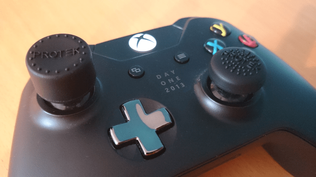 Both sizes of Protek Pro Thumb Grips on controller