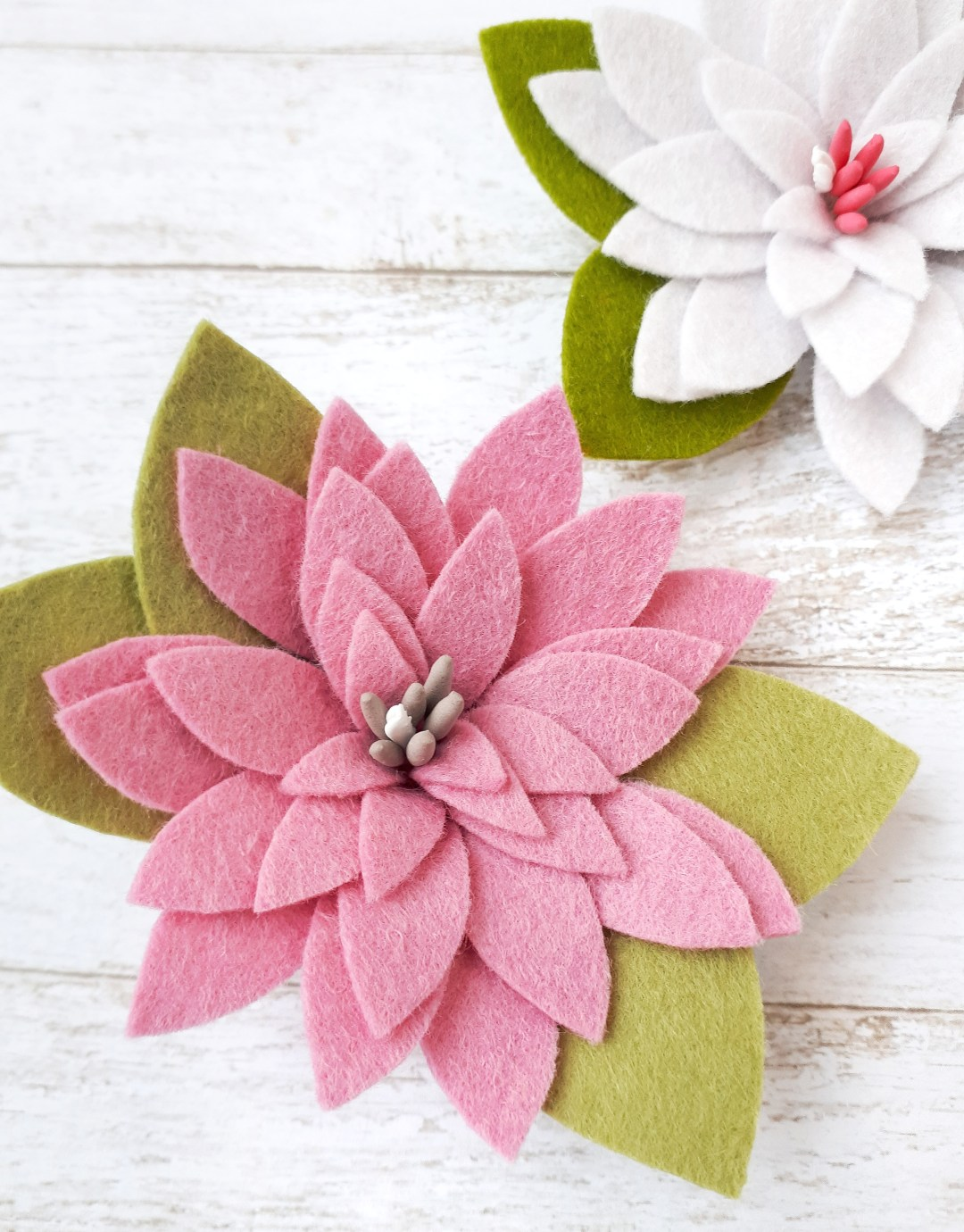 Beautiful and simple rolled felt flower tutorial. Free felt flower pattern and DIY instructions for making hair clips